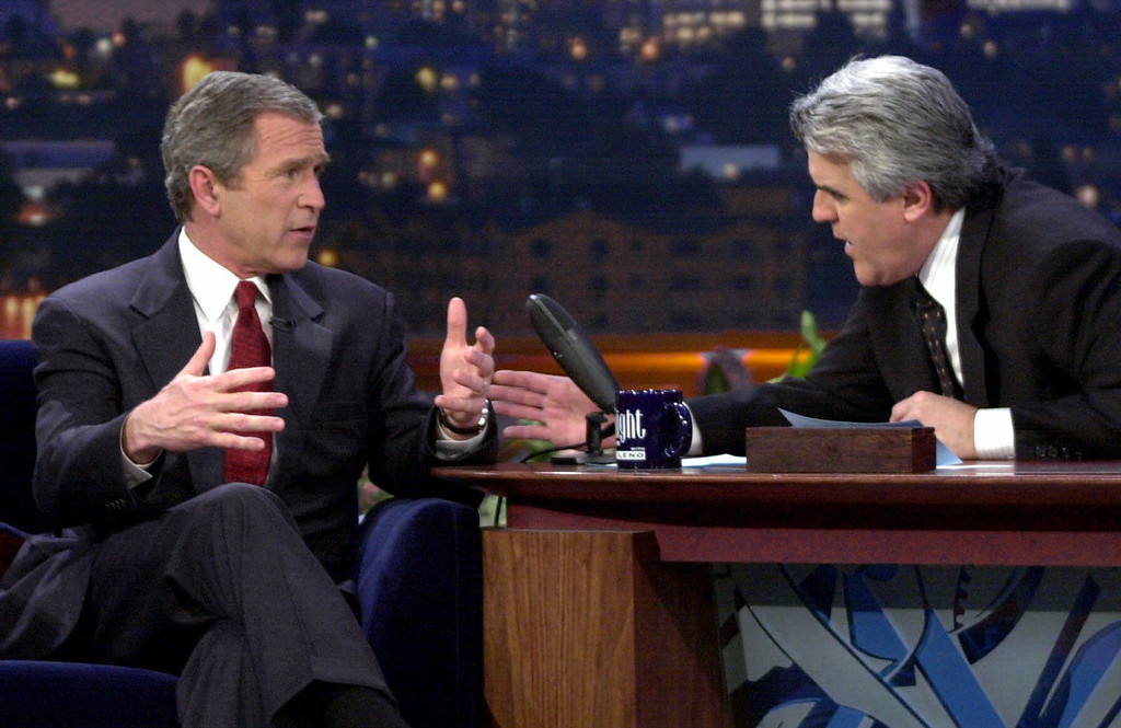 """. Republican presidential candidate Texas Gov. George W. Bush talks to Jay Leno during an appearance on \""""The Tonight Show with Jay Leno\"""" in Burbank, Calif., Monday, March 6, 2000.  (AP Photo/Eric Draper)"""