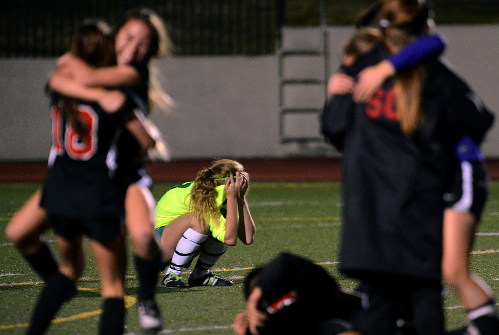 Description of . BS15-UPLANDSOCCER-01-JCM (Jennifer Cappuccio Maher/Staff Photographer) Upland's McKenna Pigoni reacts after San Clemente gets the golden goal to advance in the CIF-SS Division 1 playoffs Thursday, February 14, 2013, at Upland High School in Upland. Upland was eliminated by San Clemente 1-0 in overtime.
