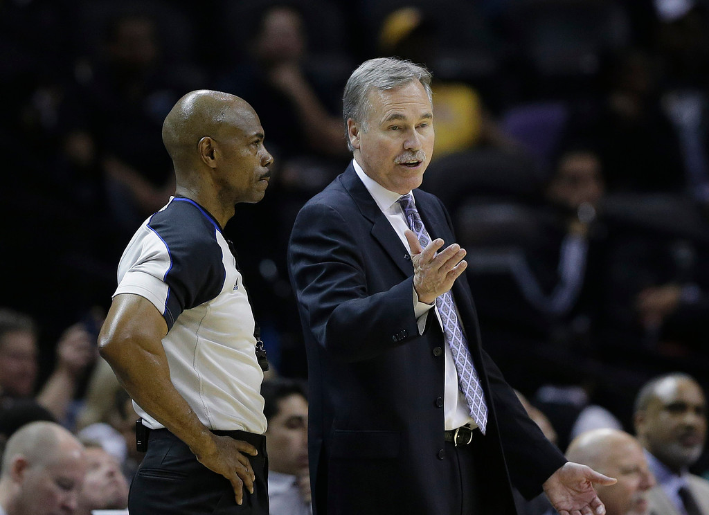 . Los Angeles Lakers coach Mike D\'Antoni, right, argues a call with an official during the second half of Game 2 of a first-round NBA basketball playoff series, Wednesday, April 24, 2013, in San Antonio, Texas. San Antonio won 102-91. (AP Photo/Eric Gay)