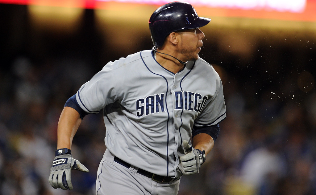 . San Diego Padres\' Kyle Blanks watches his solo home run in the sixth inning of their baseball game against the Los Angeles Dodgers on Wednesday, April 17, 2013 in Los Angeles.   (Keith Birmingham/Pasadena Star-News)