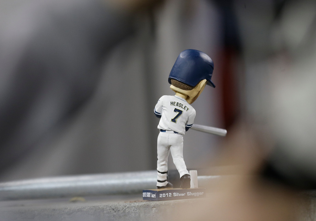 . A San Diego Padres\' Chase Headly bobble head doll sits on a ledge during  the    Padres baseball game against the Los Angeles Dodgers in San Diego, Wednesday, April 10, 2013. (AP Photo/Lenny Ignelzi)