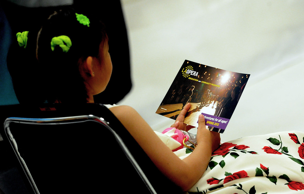 . A young child reads about the opera during a Los Angeles Opera slide show presentation on the opera �Cinderella,� composed by Gioachino Rossini at Norwood Library on Saturday, March 30, 2013 in El Monte, Calif.  (Keith Birmingham Pasadena Star-News)