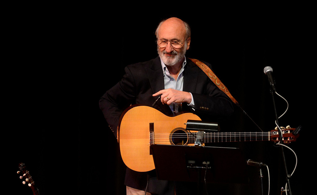 Description of . Noel Paul Stookey of Peter Paul & Mary fame performs during the One Light, Many Candles program at California State University San Bernardino March 10, 2013.  GABRIEL LUIS ACOSTA/STAFF PHOTOGRAPHER.