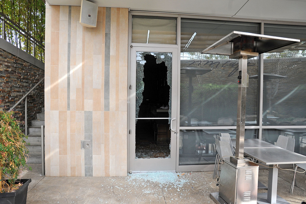 . Burglary suspects broke this window at the Neiman Marcus Cafe early Thursday at the Westfield Topanga mall in Canoga Park, CA March 7, 2013.  After breaking the window, they cut through a security gate and stole purses from the store.(Andy Holzman/Los Angeles Daily News)