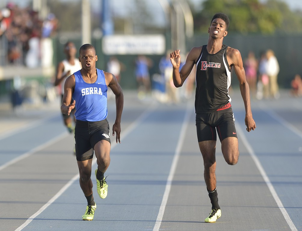 . NORWALK, CALIF. USA -- Serra\'s Ronny Hall, left, and Etiwanda\'s Miles Parish compete in the 400 meter dash during the CIF-SS Masters Track and Field Meet in Norwalk, Calif., on Friday, May 24, 2013. Photo by Jeff Gritchen / Los Angeles Newspaper Group