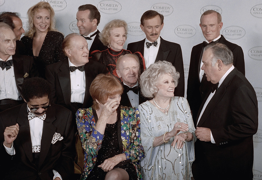 ". Jonathan Winters\' , right, middle row, droll humor draws guffaws from comedy greats waiting for a group photo at the taping of NBC\'s second annual ""Comedy Hall of Fame\"" shown on Sunday Aug. 29, 1994 in Beverly Hills, California. Left to right, front are Shirley Maclaine and Phyllis Diller; middle, Bob Hope, Nanette Fabray, Red Buttons; rear, Phil Hartman, Dick and Tom Smother. Honored for their lifetime achievement were Hope, Maclaine, and Sid Caesar, Mary Tyler Moore (not shown), George Carlin (not shown) and Richard Pryor. (AP Photo/Reed Saxon)"