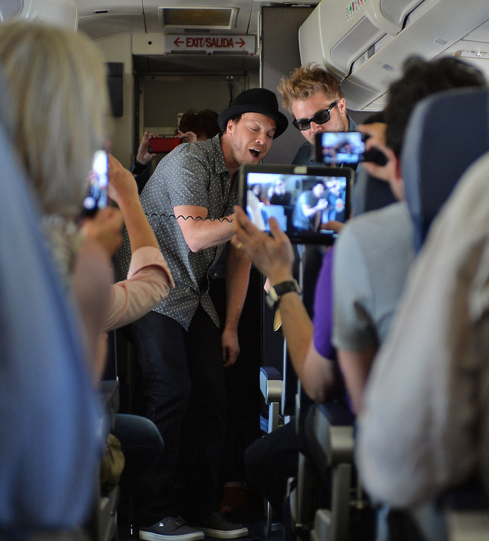. 0822_NWS_TDB-L-SOUTHWEST-- 20130821 - Los Angeles, CA -- Staff Photo: Robert Casillas / LANG --- Southwest Airlines passengers traveling from Phoenix to LAX were treated to a mini-concert by singer-songwriter Gavin DeGraw Wednesday. The performance was part of  Live at 35 series. Passengers record Gavin DeGraw performance on their portable devices.