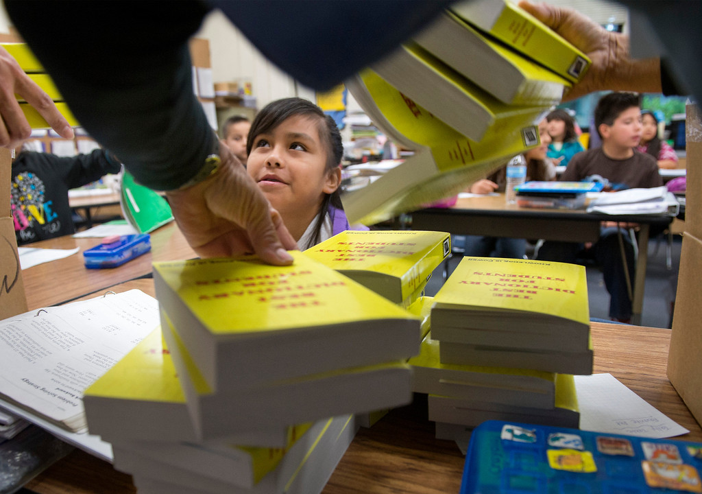 . Longfellow Elementary School third-grader Brianna Cardenas, 9, watches as members of Whittier Elks Lodge #1258 prepare to pass out free dictionaries at the Whittier campus April 8, 2013.  (SGVN/Staff photo by Leo Jarzomb)