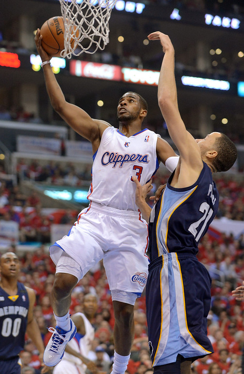 . Clippers guard Chris Paul lays in the ball aginst Tayshaun Prince of the Memphis Grizzlies during game 2 of the 2013 NBA Western Conference Playoffs April 22, 2013 in Los Angeles, CA.(Andy Holzman/Staff Photographer)