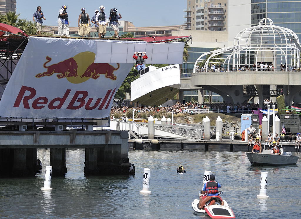 ". LONG BEACH, CALIF. USA -- Thomas Carter pilots his team\'s Flugtag entry ""Gilligan\'s Revenge\"" in Rainbow Harbor in Long Beach, Calif. on August 21, 2010. Thirty five teams competed in the Red Bull event where teams build homemade, human-powered flying machines and pilot them off a 30-foot high deck in hopes of achieving flight.  Flugtag means \""flying day\"" in German. They are on distance, creativity and showmanship..Photo by Jeff Gritchen / Long Beach Press-Telegram.."