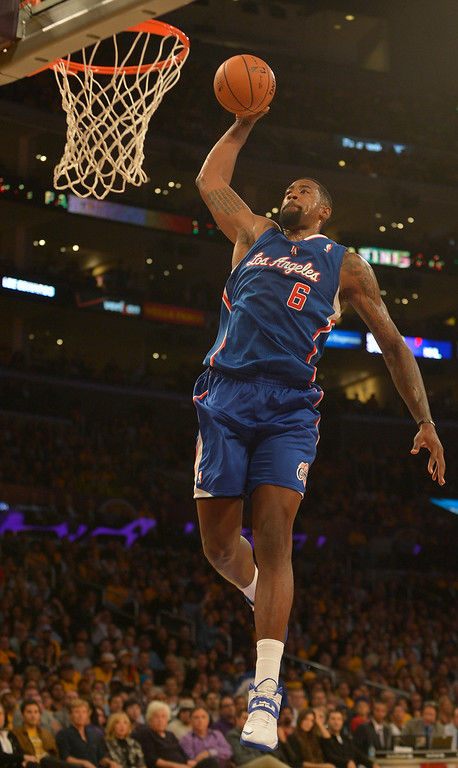 . Clippers#6 DeAndre Jordan dunks in the first quarter. The Los Angeles Lakers played the Los Angeles Clippers in the opening game of the season at Staples Center. Los Angeles, CA. 10/29/2013. photo by (John McCoy/Los Angeles Daily News)