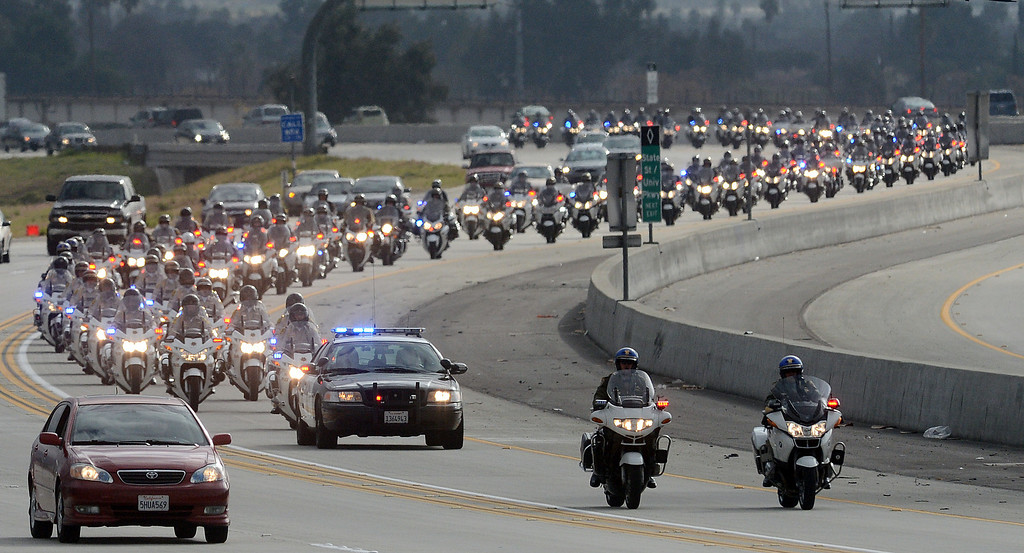 Description of . (Will Lester/Staff Photographer) The funeral procession for San Bernardino County Sheriff Detective Jeremiah Mackay stretched for over 13 miles from San Bernardino to Devore Thursday morning February 21, 2013. MacKay was shot and killed February 12 by Christopher Dorner in a fierce gun battle in the Angelus Oaks area.