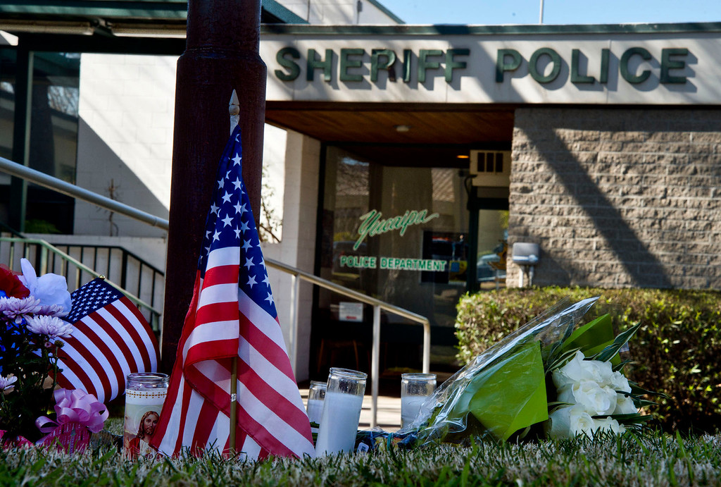 . A makeshift memorial for the San Bernardino sheriff\'s deputy at the Yucaipa Station on Wednesday, Feb. 13, 2013. The deputy was killed during a shootout with ex-LAPD officer Christopher Dorner in Big Bear yesterday.  (SGVN/Staff photo by Watchara Phomicinda)