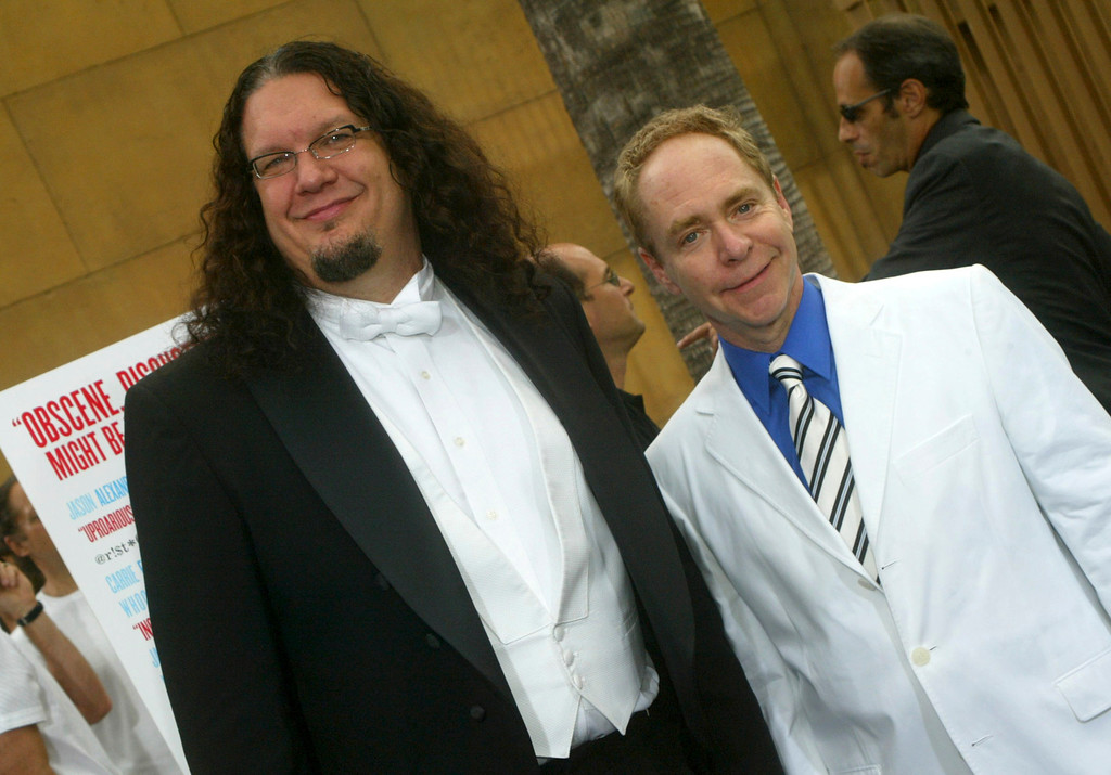 """. LOS ANGELES, CA - JULY 20: Comedians Penn Jillette (L) and Teller arrive at the Los Angeles premiere of the \""""The Aristocrats\"""" at The Egyptian Theatre on July 20, 2005 in Hollywood, California. (Photo by Matthew Simmons/Getty Images)"""