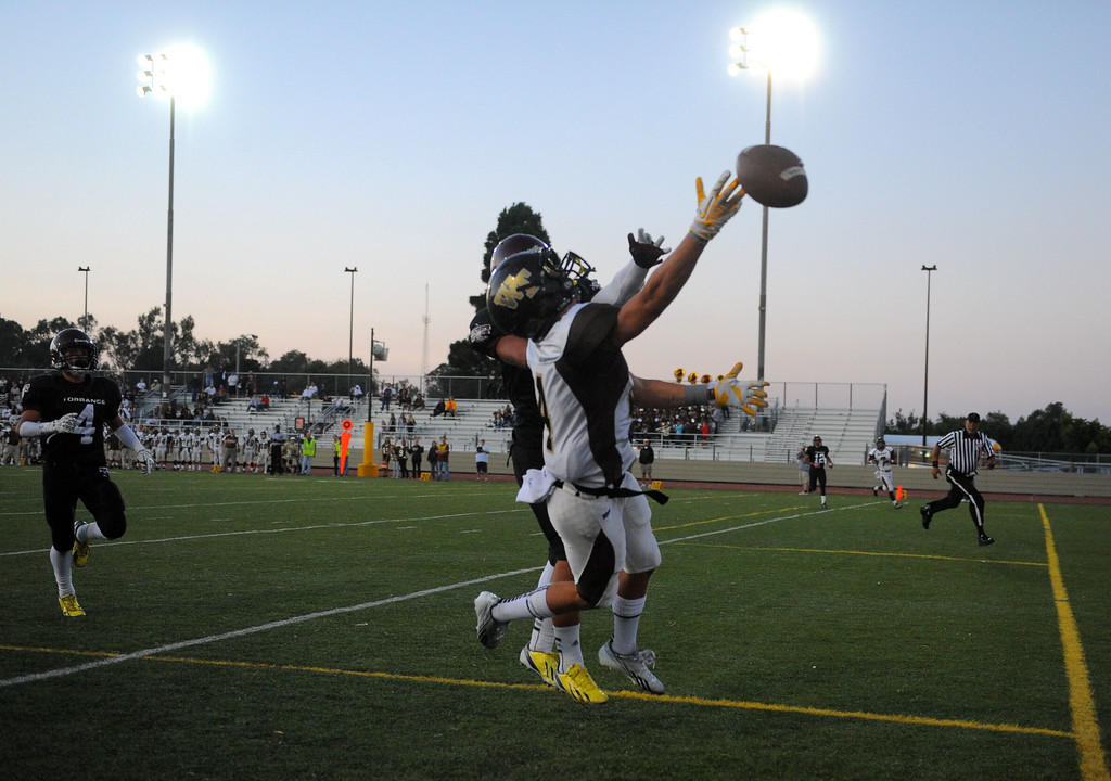 . West High takes on Torrance in a non league football game at Zamperini Stadium in Torrance, CA on Thursday, September 12, 2013. Torrance\'s Sean Luna helps break up a pass to Dale Rouse in the end zone. (Photo by Scott Varley, Daily Breeze)