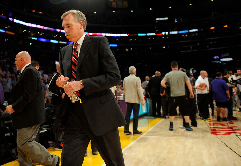 . Lakers\' coach  Mike D\'Antoni walks to the locker room after game four of their NBA Western Conference playoffs at the Staples Center Saturday, April 28, 2013. The Spurs beat the Lakers 120-89. The Spurs beat the Lakers 103-82. (Hans Gutknecht/Staff Photographer)