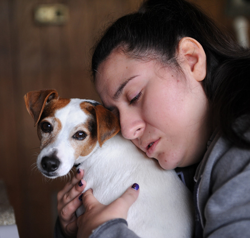 . One of the delights in Olivia Delgado\'s life is her pet dog Kiko, which she has had for about 5 years. Photo by Brad Graverson 1-9-13