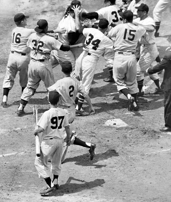 . Enos Slaughter (bald head) of the New York Yankees fights with Walt Dropo of the Chicago White Sox in the first inning of their game in Chicago, June 13, 1957.  Sox coach Johnny Cooney (34) tries to make peace, and others in the act include: catcher Elston Howard (32), Yankees pitcher Paul LaPalme, White Sox (hands outstretched); and Joe Collins (15) of the Yankees.  (AP Photo/Harry Hall)