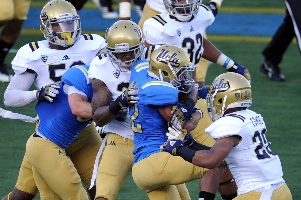 Description of . UCLA wide receiver Roosevelt Davis (22) runs for yardage during the football spring showcase college football game in the Rose Bowl on Saturday, April 27, 2013 in Pasadena, Calif.    (Keith Birmingham Pasadena Star-News)