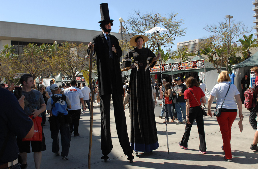 . 04/20/13 - Stilt walkers make their way through the crowd at the 39th Annual Toyota Grand Prix of Long Beach. Photo by Brittany Murray / Staff Photographer