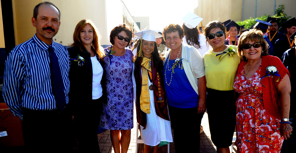Description of . Student Emma Islas poses for a picture with her teachers during the Montebello High School commencement at Montebello High School on Thursday, June 20, 2013 in Montebello, Calif.  (Keith Birmingham/Pasadena Star-News)