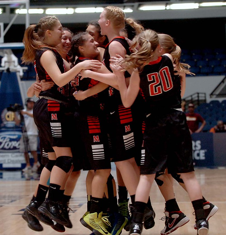 . Mesa Grande Academy girl\'s basketball team the Cardinals celebrate their win after beating AGBU Titans Wednesday February 27, 2013 during the CIF Ford Southern Section Girl\'s Division 5A Championship at the Anaheim Convention Center in Anaheim.LaFonzo Carter/ Staff Photographer