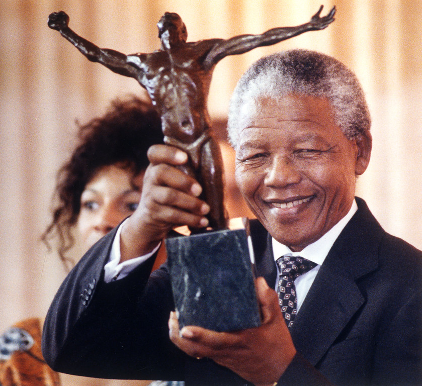 . July 1993: African National Congress president Nelson Mandela shows off a  statue he received at First African Methodist Episcopal Church during his visit to Los Angeles.  Daily News file photo