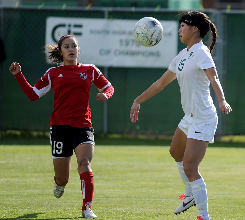 . 02-21-2012--(LANG Staff Photo by Sean Hiller)- South Torrance girls soccer beat Artesia 5-0 in Thursday\'s CIF Southern Section Division IV quarterfinal at South High. Artesia\'s Icseel Ortiz moves in to guard South\'s Noelle Ly (15).