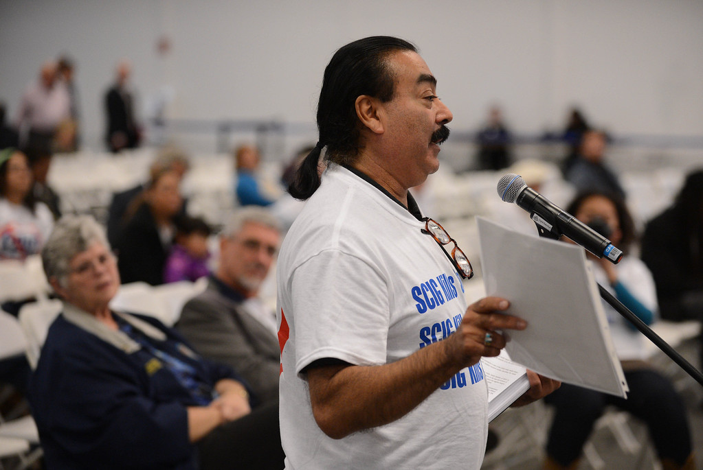 . Jesse Marquez brought out a stack of death certificates of local residents who have died of pulmonary causes recently hoping to sway the LA Harbor Commission meeting to determine the fate of the SCIG rail terminal, or Southern California International Gateway.    Photo by Brad Graverson 3-7-13