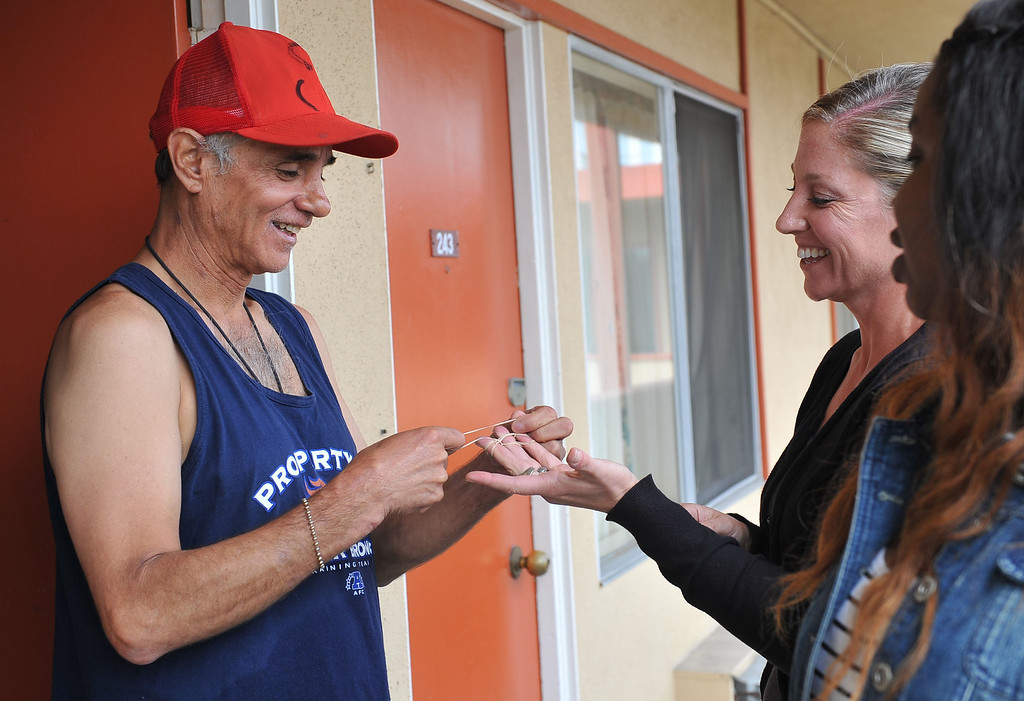 . 080913 - L-R Felipe Rodriguez shares a moment of laughter with Lesley Braden, a registered nurse from Homeless Innovations Project of Mental Health America. Rodriguez has been a client since November 2012 after 7 years of being homeless. Braden administers his medication every 3 days to prevent mis-use or abuse. Photo by Brittany Murray, Press Telegram