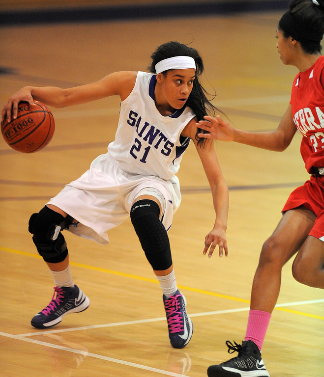 . LONG BEACH - 02/20/13 - (Photo: Scott Varley, Los Angeles Newspaper Group)  Serra and St. Anthony meet in the Quarterfinals of the Division 4AA CIF-SS girls basketball playoffs. St. Anthony\'s Jordan Jackson switches direction as she brings the ball down the court.
