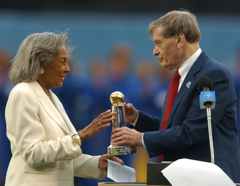Description of . Baseball commissioner Bud Selig gives Rachel Robinson the Commissioner's Historic Achievement Award at Dodger Stadium before the game against the San Diego Padres, Sunday April 15, 2007. (Michael Owen Baker/Los Angeles Daily News)