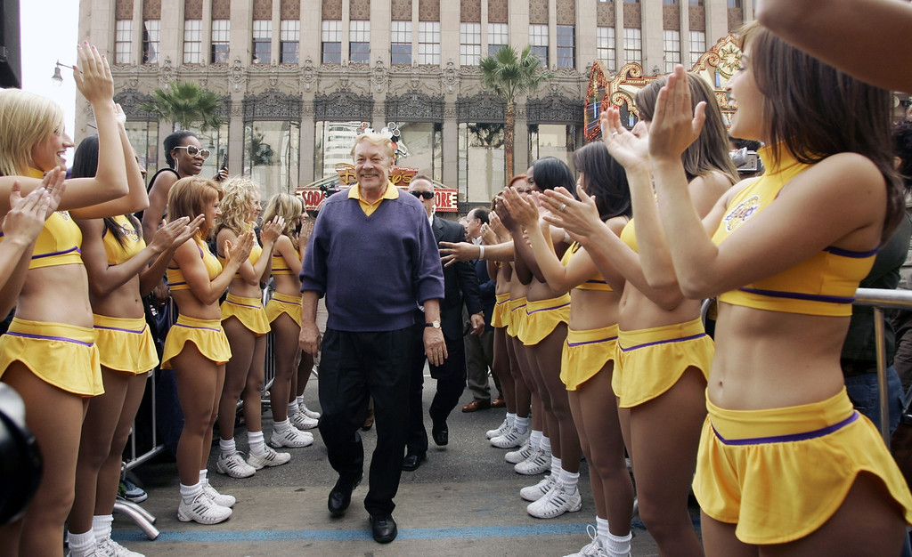 Description of . Jerry Buss, center, owner of the Los Angeles Lakers, is greeted by the Lakers Girls cheerleaders, after being honored with a television star on the Hollywood Walk of Fame in the Hollywood section of Los Angeles, Monday, Oct. 30, 2006. (AP Photo/Damian Dovarganes)