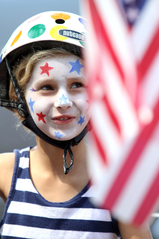 . July 4, 2013-Photo by Tracey Roman/for the Press-Telegram  Taylor Carty shows her holiday spirit as she participates in the Los Altos 4th of July bike parade through the streets of East Long Beach.