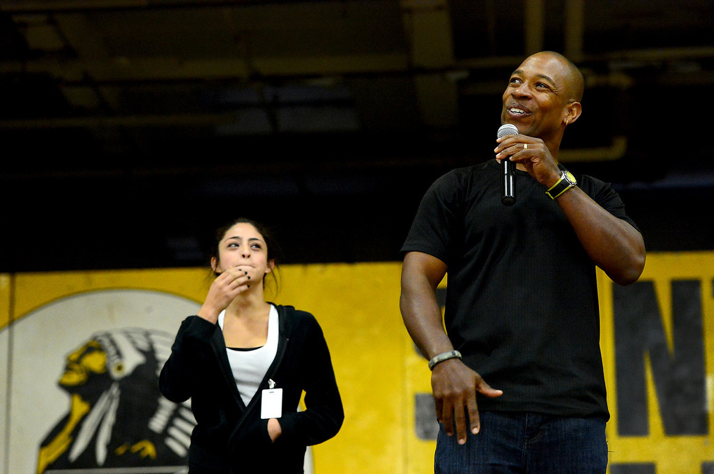 Description of . Shiane Urbano, 16, a sophomore, joins motivational speaker Keith Hawkins as he speaks to students at Santa Fe High School Tuesday morning, March 19, 2013 during  the Santa Fe Springs school's 23rd annual Diversity Summit this week. (SGVN/Staff Photo by Sarah Reingewirtz)
