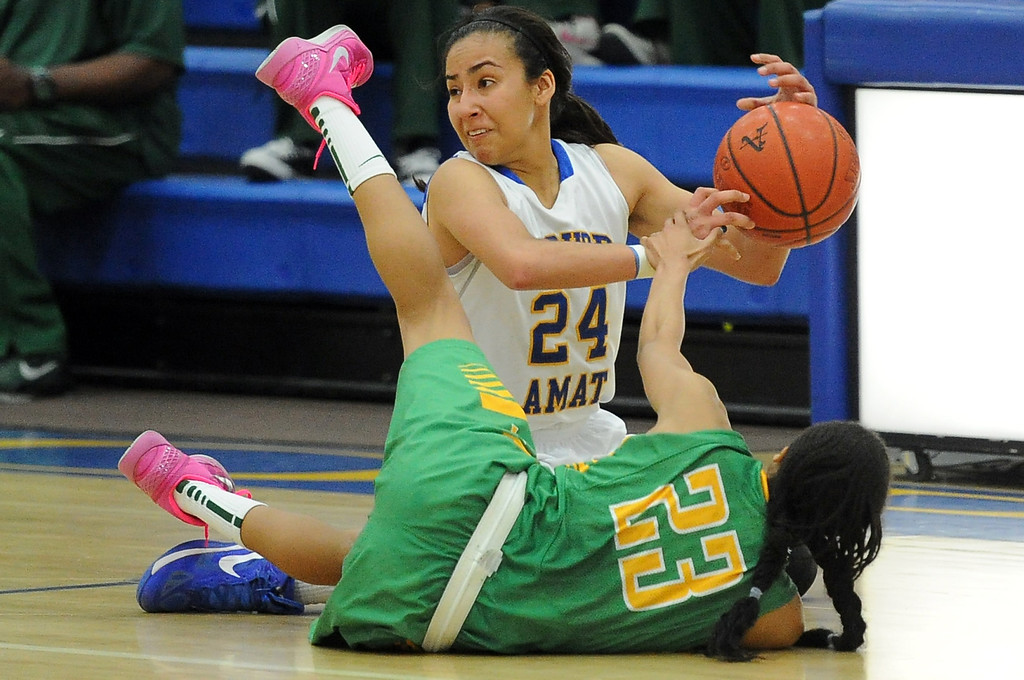 Description of . Bishop Amat's Jennifer Vasquez (24) scrambles for the loose ball with Long Beach Poly's Arica Carter (23) in the second half of a CIF State Southern California Regional semifinal basketball game at Bishop Amat High School on Tuesday, March 12, 2013 in La Puente, Calif. Long Beach Poly won 52-34.  (Keith Birmingham Pasadena Star-News)