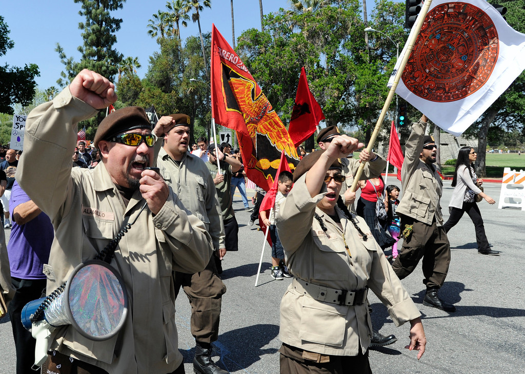 . National Brown Berets march down San Fernando Mission Blvd. Approximately 4,000 Angelinos marched 2 miles from Brand Park to Ritchie Valens Park during the Annual Cesar Chavez March for Justice. Mission Hills, CA 3/23/2013(John McCoy/Staff Photographer