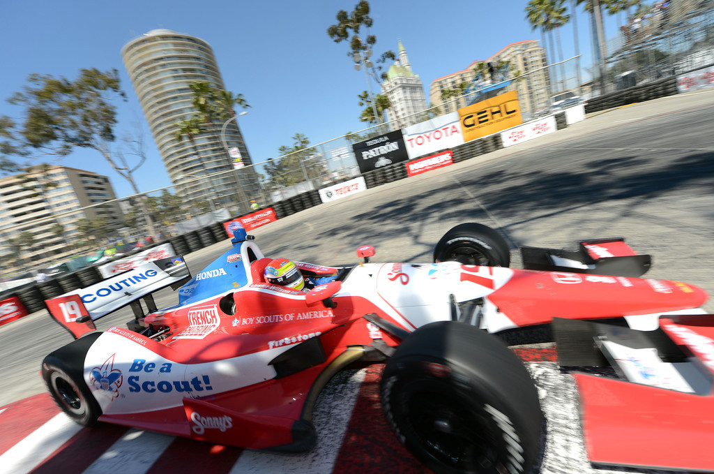. (Will Lester/Staff Photographer)  Indycar driver Justin Wilson drives through the hairpin during the Friday afternoon practice session April 19, 2013 at the 39th annual Toyota Grand Prix of Long Beach.