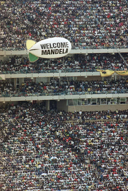 . The Feb 13, 1990 file photo shows a balloon bearing a welcome sign for Nelson Mandela airborne over Soweto\'s Soccer City stadium, where the released ANC leader addressed the crowd of 120,000 packed into the venue.  On Sunday, before a global TV audience, Soccer City stadium will be the grand stage for a World Cup final. For many South Africans, the site has been hallowed ground for two decades _ not because of sports, but as a historic venue in the anti-apartheid struggle. In October 1989, with apartheid still in force, Soccer City\'s precursor stadium hosted an electrifying rally at which more than 70,000 blacks greeted newly freed leaders of the still-outlawed African National Congress _ most of its long-imprisoned hierarchy except Nelson Mandela.  Less than four months later, an even bigger, more euphoric crowd overflowed FNB Stadium to welcome home Mandela himself, the paramount ANC leader, at last freed unconditionally by the white-minority government after 27 years in prison.  (AP Photo/Sean Woods)