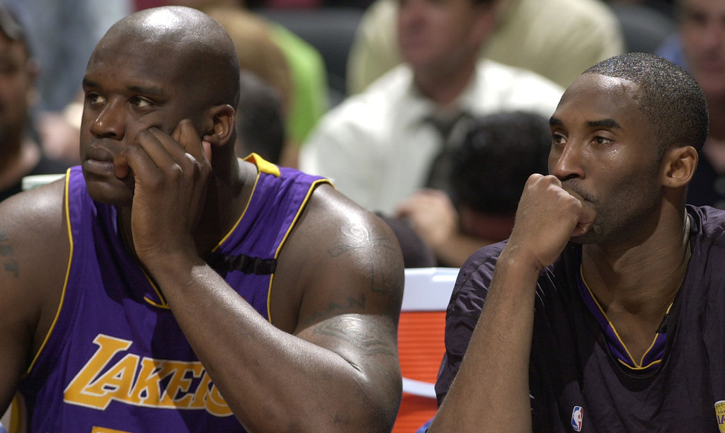 . Los Angeles Lakers\' Shaquille O\'Neal, left, and Kobe Bryant, right, sit on the bench during the fourth quarter in Game 2 of the Western Conference semifinals against the San Antonio Spurs on Wednesday, May 7, 2003, in San Antonio. The Spurs beat the Lakers 114-95 to take a 2-0 lead in the best-of-seven series. (AP Photo/David J. Phillip)