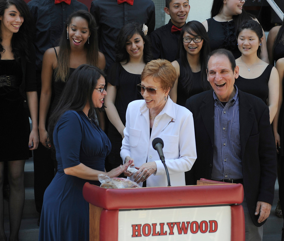 ". Hollywood High School Principal Alejandra Sanchez, Carol Burnett and director of the performing arts magnet Story Sacks. Burnett, award-winning actress, comedienne and best-selling author, was honored by the City of Los Angeles for her lifetime achievements with the naming of Carol Burnett Square at the intersection of Highland Avenue and Selma Avenue. The Square is adjacent to Hollywood High School where Burnett attended. Students from the school choir, ""H2O\"" sang �I�m so glad we had this time together,� before Burnett and LA City Councilman Tom LaBonge unveiled her street sign. Hollywood, CA 4/18/2013(John McCoy/Staff Photographer"