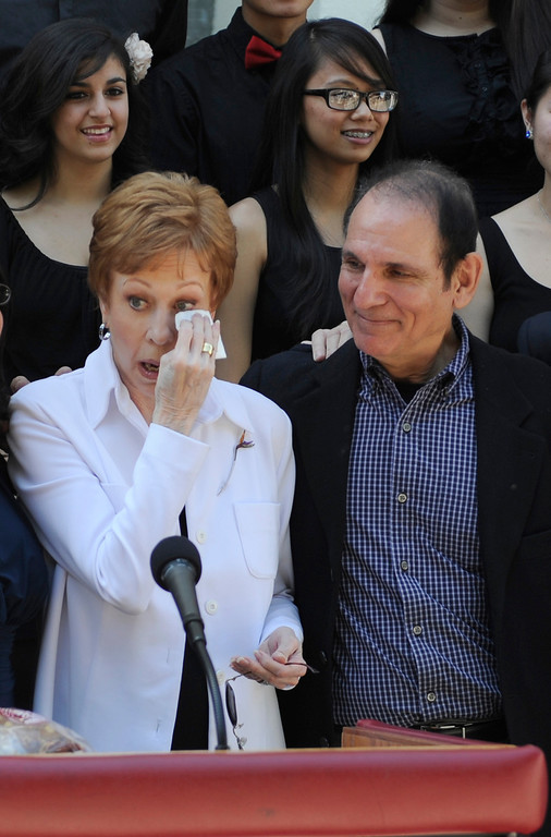 ". Carol Burnett shows her emotion after listening to the choir sing. Burnett stands next to Stormy Sacks, the director of the performing arts magnet at Hollywood High School. Burnett, award-winning actress, comedienne and best-selling author, was honored by the City of Los Angeles for her lifetime achievements with the naming of Carol Burnett Square at the intersection of Highland Avenue and Selma Avenue. The Square is adjacent to Hollywood High School where Burnett attended. Students from the school choir, ""H2O\"" sang �I�m so glad we had this time together,� before Burnett and LA City Councilman Tom LaBonge unveiled her street sign. Hollywood, CA 4/18/2013(John McCoy/Staff Photographer"