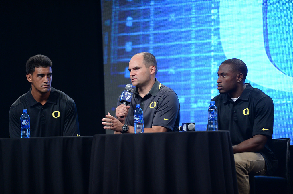 . Oregon Coach Mike Helfrich, players Marcus Mariota (QB) left and Ifo Ekpre-Olomu (CB) right. Pac12 media Day at Sony Studios.  Photo by Brad Graverson 7-26-13