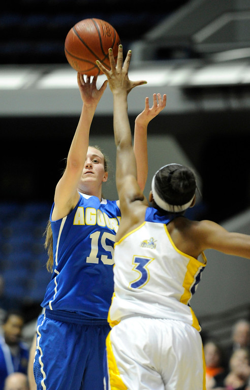 . Agoura #15 Kim Jacobs shoots over Gahr #3 Jewlyn Sawyer. Agoura defeated Gahr 60-39 in the CIF-SS Division III-AAA Girls Basketball Championship at the Anaheim Convention Center in Anaheim, CA 2/23/2013(John McCoy/Staff Photographer)