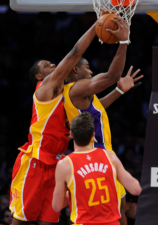 . Lakers#4 Antawn Jamison is fouled by Rockets#6 Terrence Jones as Rockets#25 Chandler Parsons looks on in the first quarter. The Lakers faced the Houston Rockets in the final home game of the year at Staples Center in Los Angeles, CA 4/17/2013(John McCoy/Staff PhotographerThe Lakers faced the Houston Rockets in the final home game of the year at Staples Center in Los Angeles, CA 4/17/2013(John McCoy/Staff Photographer