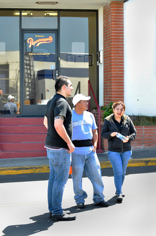 . Outside a secondary Popcornopolis building in El Segundo employees watch activity down the street where an armed female employee took another employee hostage. Drama ended peacefully  four hours later around noon. Photo by Brad Graverson 4-16-13