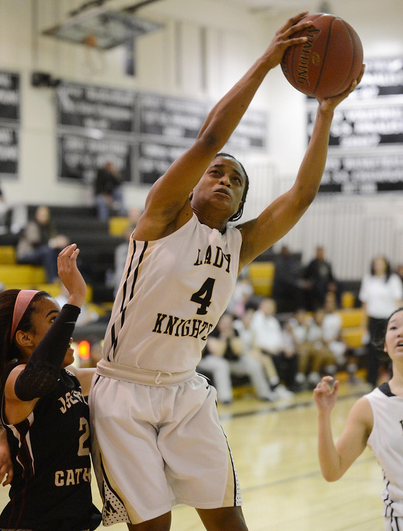 . Bishop Montgomery\'s Chelsea Lidy (4) pulls down an offensive rebound over JSerra\'s August Touchard (2) in a CIF Division IV-AA quarterfinal game Wednesday night in Torrance. 20130220 Photo by Steve McCrank / Staff Photographer