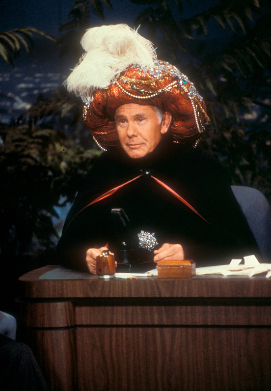 """. In this undated photo provided by NBC, Johnny Carson begins an episode of the \""""Tonight Show\"""" as \""""Carnac, The Magnificent!\""""  Carson died Sunday, Jan. 23, 2005 according to his nephew. He was 79.  (AP Photo/NBC, Chris Haston)"""