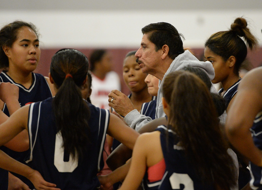 . Leuzinger coach Bo Corona talks to his team as they are down in the first quarter against Lawndale Tuesday, December 10, 2013, in Lawndale, CA.  Photo by Steve McCrank/DailyBreeze