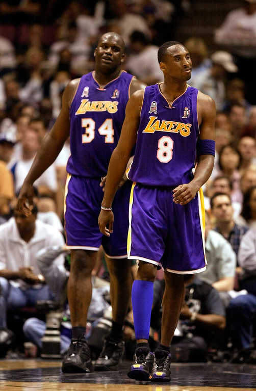 . Los Angeles Lakers\' Shaquille O\'Neal, left, and Kobe Bryant react during the second half of Game 3 of the NBA Finals against the New Jersey Nets in East Rutherford, N.J., Sunday, June 9, 2002. (AP Photo/Rusty Kennedy)